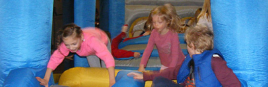 Photo of children on a bouncy castle at Fun on the Green